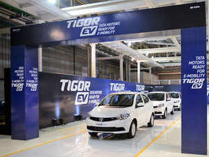 Ratan Tata and N Chandrasekaran roll out the first batch of Tata Tigor EVs from Sanand factory