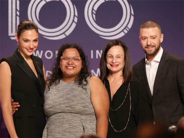 From left, Gal Gadot, Carla Arellano, Laurie Zaks and Justin Timberlake pose onstage at The Hollywood Reporter's 2017 Women In Entertainment Breakfast.