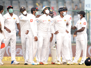 Sri Lankan players, wearing masks in the view of air-pollution.