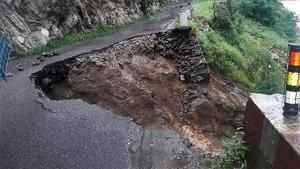 Uttarkashi: The damaged road at Gangnani due to heavy rains in Uttarkashi distri...
