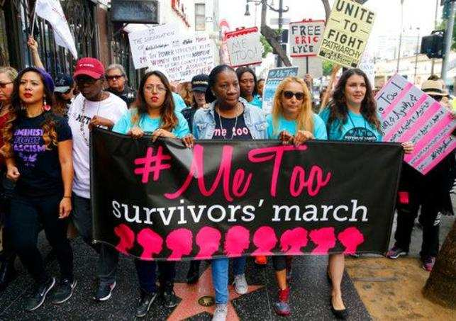 Participants march against sexual assault and harassment at the #MeToo March in the Hollywood section of Los Angeles on Sunday, Nov. 12, 2017.Photo/Damian Dovarganes)