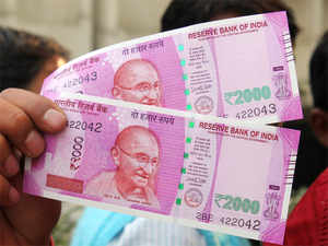 rs 2000 notes rbi may be holding back rs 2 000 notes says sbi