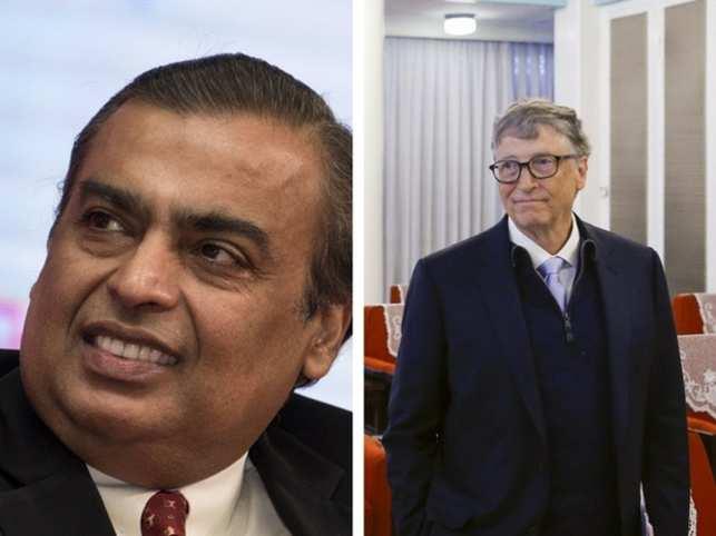 On the left, Mukesh Ambani and right, Bill Gates.
