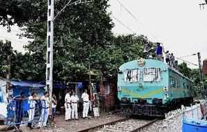 Kolkata: Railway workers inspect an overhead railway electrical line after devot...