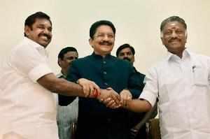 Chennai: Tamil Nadu Chief Minister K Palaniswami greeting O Panneerselvam after ...