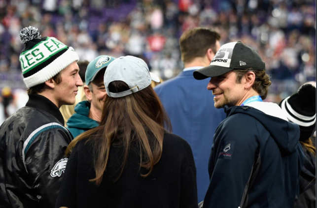 On the left, Miles Teller and on the right, Bradley Cooper were seen on the pitch ahead of the game between Philadelphia Eagle and New England patriots in Minneapolis.
