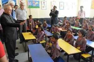 Murshidabad: President Pranab Mukherjee interacts with students in a class-room ...