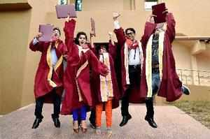 Chennai: Students jubilate after receiving their degrees at the 54th Convocation...