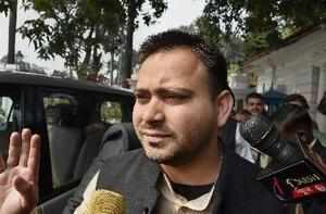 Patna: RJD leader Tejashwi Yadav speaks to media outside Raj Bhawan after his me...