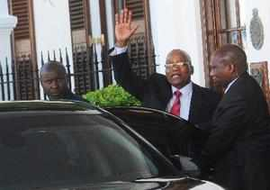Cape Town : South African President Jacob Zuma, waves as he leaves parliament in...