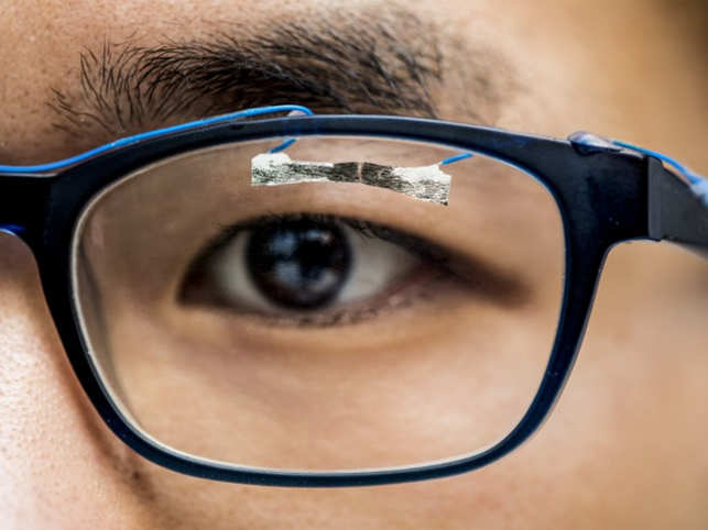 University of Washington graduate student, Jinyuan Zhang, demonstrates how wearable sensors can track eye movement. (Image: University of Washington)
