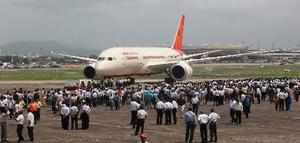 FILE PHOTO:::: New Delhi: Air India employees gather around a newly acquired Air...