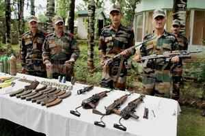 Uri: Army displaying arms and ammunition recovered from the infiltrators killed ...