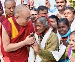 Bodh Gaya: Tibetan spiritual leader the Dalai Lama meets with local workers at a...