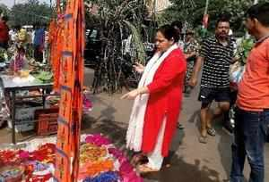 Patna: RJD chief LalU Prasad's daughter and MP Misa Bharti buying Puja items at ...