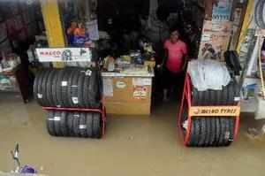 Nagpur: A waterlogged tyre shop at a market after heavy rains in Nagpur, Maharas...