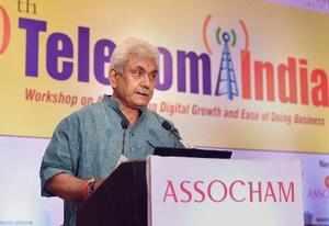 New Delhi : Telecom Minister Manoj Sinha addresses Telecom India workshop in New...