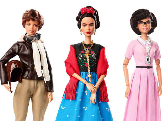 (L-R) Barbie shows dolls in the image of pilot Amelia Earhart, Mexican artist Frida Khalo and mathematician Katherine Johnson.