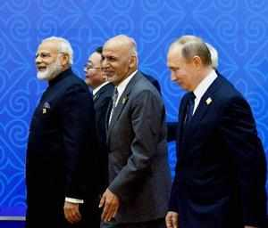 Astana: Prime Minister Narendra Modi with Afghan president Ashraf Ghani and the ...