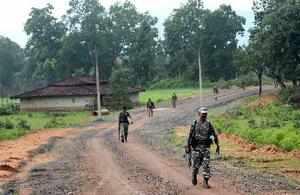 Latehar: CRPF personnel patrol a Maoist-affected village in Garu, Latehar on Wed...
