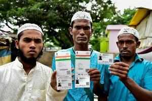 Chennai: Rohingya Muslim people showing their Aadhaar Cards at Kelambakkam in Ch...