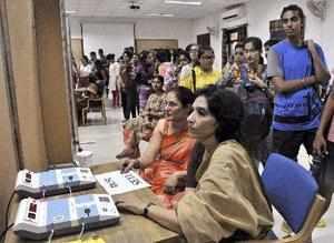 New Delhi: Students queue up to cast their votes for the Delhi University Studen...