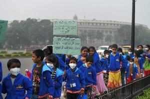 New Delhi: Children wearing air pollution masks attend a demonstration to sprea...