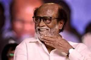 Chennai: Tamil actor Rajinikanth gestures at an event where he unveiled a statue...