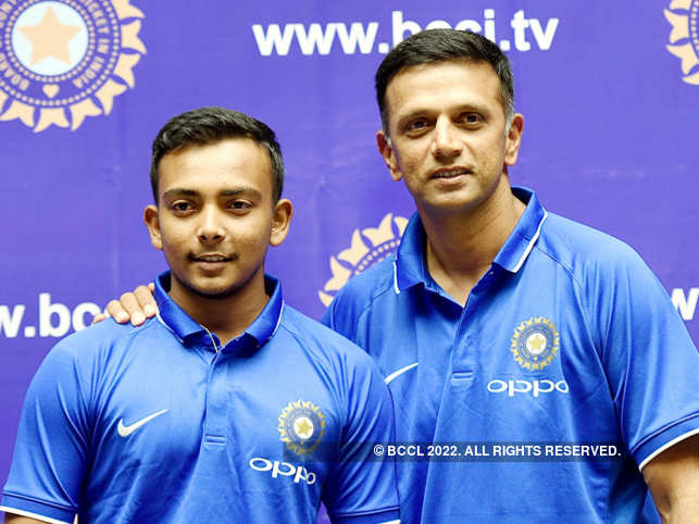 Coach Rahul Dravid refused to accept a Rs 50 lakh bonus cheque after the World Cup win of the under-19 team, led by Prithvi Shaw (left).