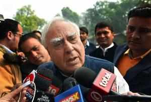 New Delhi: Congress leader Kapil Sibal addresses the media on 2G outside the Par...