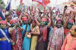Gorakhpur: Samajwadi Party member celebrate the success of their party in the Lo...