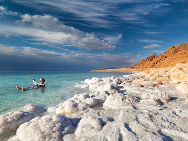 Liberally smear a thick layer of mud from the banks of the Dead Sea. Read your favourite book or just soak up some sunlight as you float effortlessly in the waters.