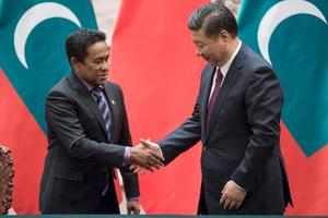 Beijing : Maldives' President Abdulla Yameen, left, shakes hands with China's Pr...