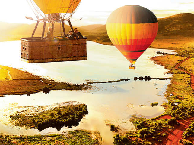 ABOVE THE CLOUDS: Hot-air ballooning brings in a leisurely pace to your early morning adventure. Plan a romantic soiree to mark your special occasion
