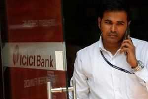 An employee exits an ICICI bank branch in Mumbai