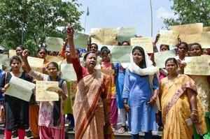 Ranchi: SC/ST community women hold placards and raise slogans to protest against...