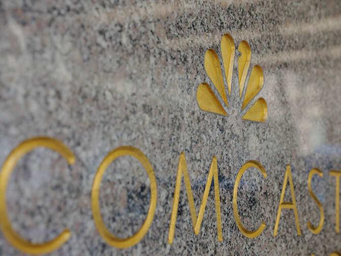 Comcast formally takes on Murdoch with £22bn Sky bid
