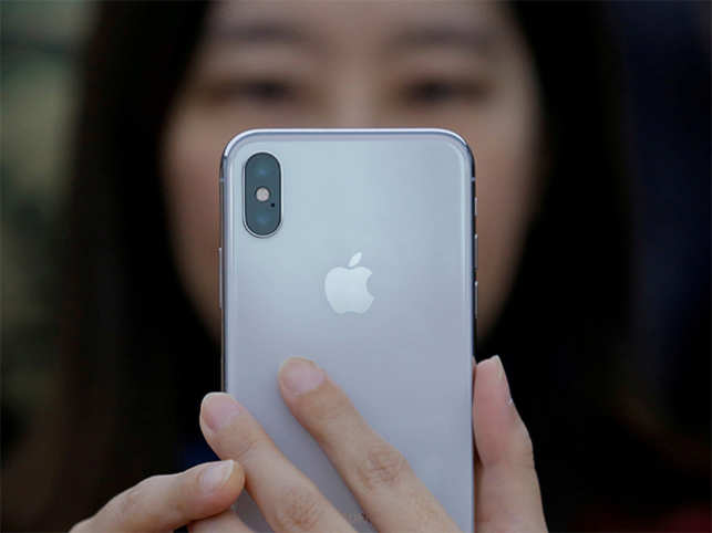 Apple reports $13.8B profit, despite slow iPhone sales