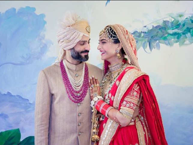 Sonam Kapoor and Anand Ahuja tied the knot in a Sikh ceremony in Mumbai. The bride wore a red Anuradha Vakil lehenga and the groom was dressed in a custom-made achkan by designer Raghavendra Rathore.