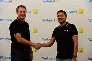 Walmart CEO Doug McMillon with Flipkart Co-Founder and CEO Binny Bansal