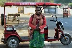 New Delhi: Binota (45), said to be Delhi's first female e-rickshaw driver, poses...