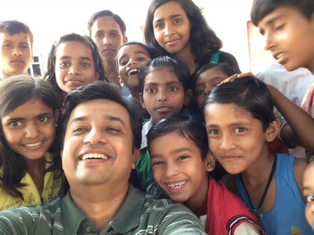 Saakar S Yadav with children from a village