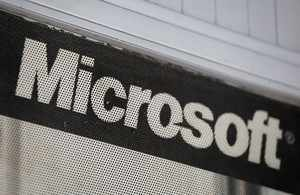 FILE PHOTO: The Microsoft logo is pictured at a service centre in New Delhi