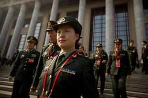 Beijing: Male and female Chinese military delegates walk down the steps of the G...