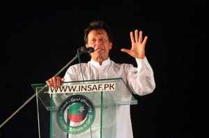 Imran Khan, chairman of the Pakistan Tehreek-e-Insaf (PTI) political party, gestures as he addresses his supporters during a rally in Lahore