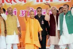 Azamgarh: Uttar Pradesh Chief Minister Yogi Adityanath waves at the crowd during...