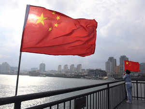 China-flag-AFP