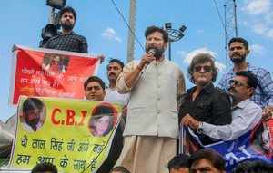 Jammu: Former BJP minister Choudhary Lal Singh leads a protest rally in support ...