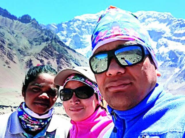 After a year's training, two women mountaineers and an instructor climb summit of Mount Everest