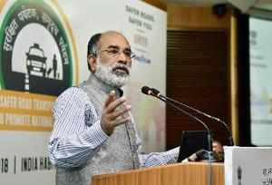 New Delhi: Union Tourism and IT Minister Alphons Kannanthanam speaks during the ...